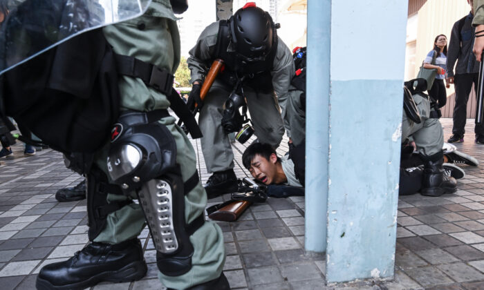 A protestor arrested by riot police in Wong Tai Sin district in Hong Kong, on Nov. 11, 2019. (Billy H.C. Kwok/Getty Images)