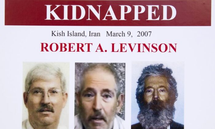 An FBI poster showing a composite image of former FBI agent Robert Levinson (R) of how he would look like now after five years in captivity; an image (C) taken from the video, released by his kidnappers; and a picture before he was kidnapped, displayed during a news conference in Washington in March 6, 2012. (Manuel Balce Ceneta/AP)