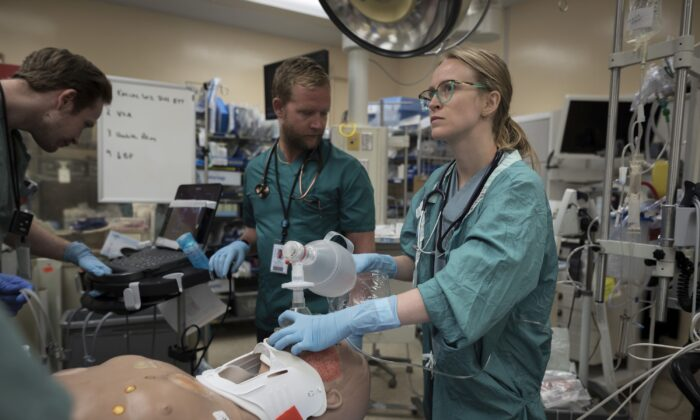 Medical staff perform a procedure on a medical mannequin at St. Michael's Hospital in Toronto on Aug. 13, 2019. A private members bill that would protect the conscience rights of medical professionals in Alberta has inspired both praise and controversy. (The Canadian Press/ Tijana Martin)