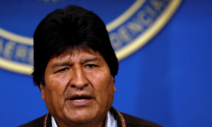 Bolivia's President Evo Morales addresses the media at the presidential hangar in the Bolivian Air Force terminal in El Alto, Bolivia, Nov. 10, 2019. (Carlos Garcia Rawlins/Reuters)