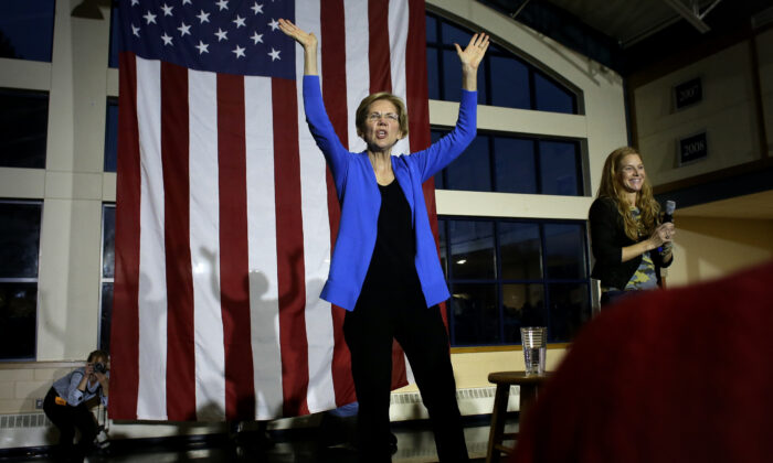 Democratic presidential candidate Sen. Elizabeth Warren (D-Mass.) center, addresses an audience during a campaign event in Exeter, N.H. on Nov. 11, 2019. (Steven Senne/AP Photo)