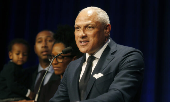 Mississippi Democrat Mike Espy stands with family members as he talks to supporters in a crowded auditorium at the Mississippi Civil Rights Museum in Jackson, Mississippi on Nov. 27, 2018. (AP Photo/Charles A. Smith, File)