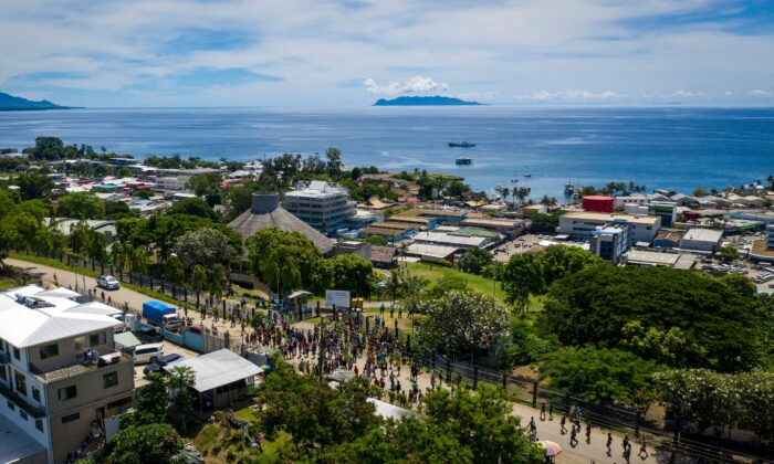 Protestors gather outside the Parliament House building during the veteran politician Manasseh Sogavare press conference in Honiara, Solomons Islands, on April 24, 2019. (Robert Taupongi/AFP via Getty Images)