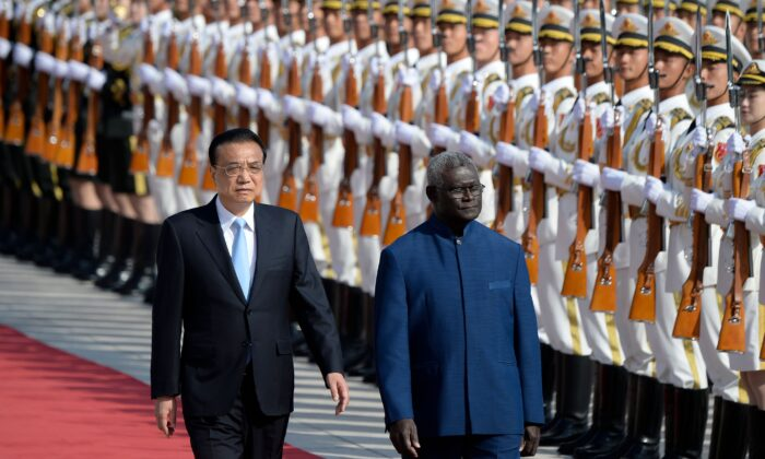 Solomon Islands Prime Minister Manasseh Sogavare (R) and Chinese Premier Li Keqiang inspect honour guards during a welcome ceremony at the Great Hall of the People in Beijing on Oct. 9, 2019. (Wang Zhao/AFP via Getty Images)