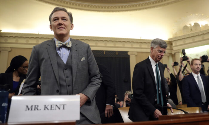 Career Foreign Service officer George Kent and top U.S. diplomat in Ukraine William Taylor arrive to testify before the House Intelligence Committee on Capitol Hill in Washington on Nov. 13, 2019. (AP Photo/Andrew Harnik)