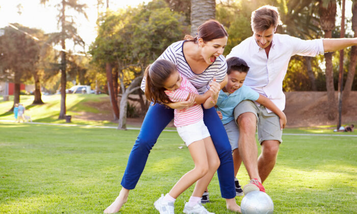Make time to move your body for increased energy and reduced stress. A great way to get this done is to play an active game with your children.  (Shutterstock)