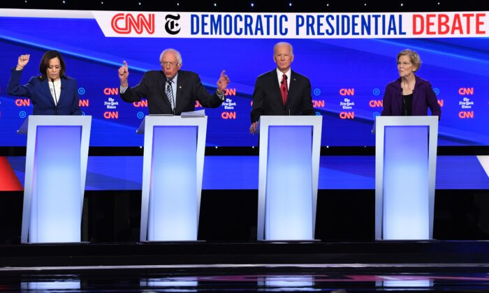 Democratic presidential hopefuls (from L) California Senator Kamala Harris, Vermont Senator Bernie Sanders, former Vice President Joe Biden and Massachusetts Senator Elizabeth Warren take part in the fourth Democratic primary debate of the 2020 presidential campaign season co-hosted by The New York Times and CNN at Otterbein University in Westerville, Ohio on Oct. 15, 2019. (SAUL LOEB/AFP via Getty Images)