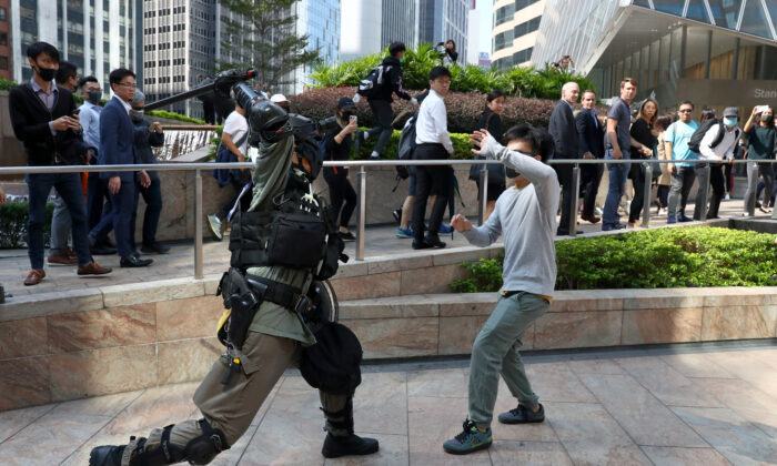 A riot police officer clashes with an anti-government protester during a demonstration at the Central District in Hong Kong on Nov.13, 2019. (Athit Perawongmetha/Reuters)