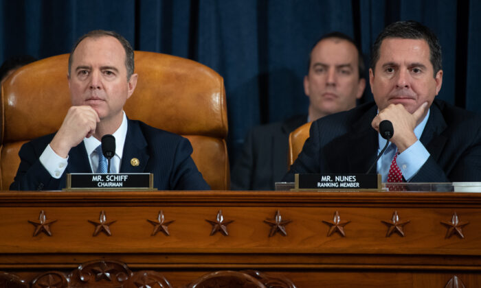 (L-R) House Intelligence Committee Chairman Adam Schiff (D-Calif.) and ranking member of the House Intelligence Committee Devin Nunes (R-Calif.) listen to testimony during the first public hearings held by the House Permanent Select Committee on Intelligence as part of the impeachment inquiry into U.S. President Donald Trump on Capitol Hill in Washington on Nov. 13, 2019. (Saul Loeb - Pool/Getty Images)