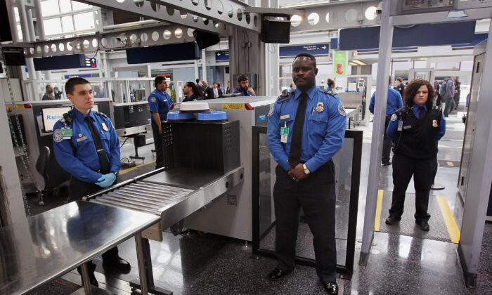 Transportation Security Administration (TSA) officers staff a checkpoint at O'Hare International Airport in Chicago, Ill., on March 15, 2010. (Scott Olson/Getty Images)