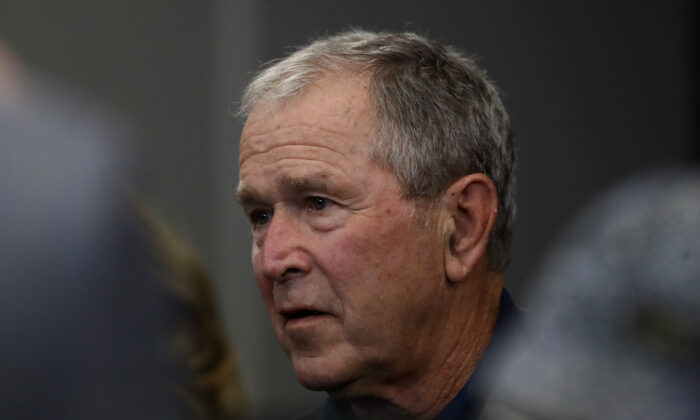 Former President George W. Bush watches the NFL game between the Dallas Cowboys and the Green Bay Packers at AT&T Stadium in Arlington, Texas, on Oct. 6, 2019. (Ronald Martinez/Getty Images)