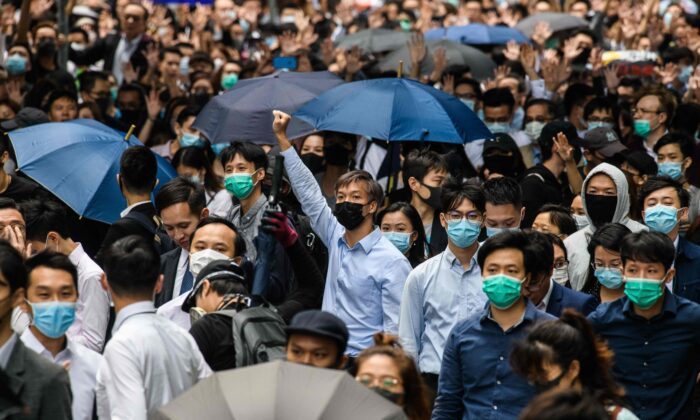 Office workers and pro-democracy protesters gather during a demonstration in Central in Hong Kong on Nov. 12, 2019. (Anthony Wallace/AFP via Getty Images)