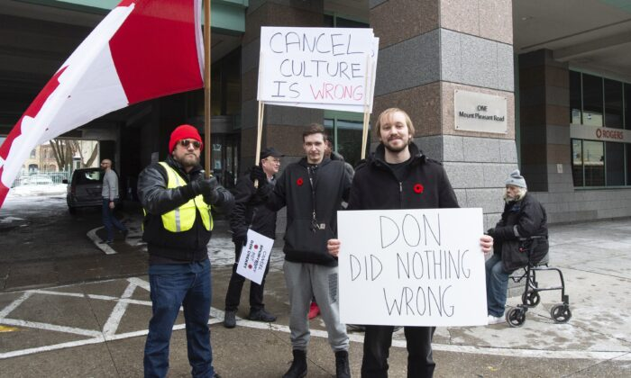 Don Cherry supporters stand outside Rogers head office in Toronto on Nov. 13, 2019. (The Canadian Press/Frank Gunn)