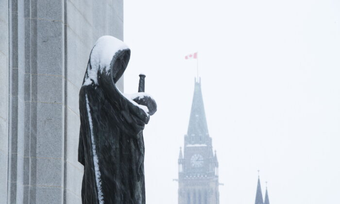 The Peace Tower of Parliament Hill is seen past the Statue of Justice at the Supreme Court of Canada in Ottawa on Nov. 14, 2019.  (The Canadian Press/Sean Kilpatrick)