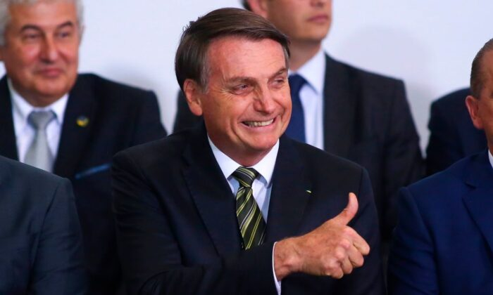 Brazilian President Jair Bolsonaro gestures during a ceremony to commemorate the 300 days of Bolsonaro's administration at Planalto Palace in Brasilia, Brazil, on Nov. 5, 2019. (Sergio Lima/AFP via Getty Images)