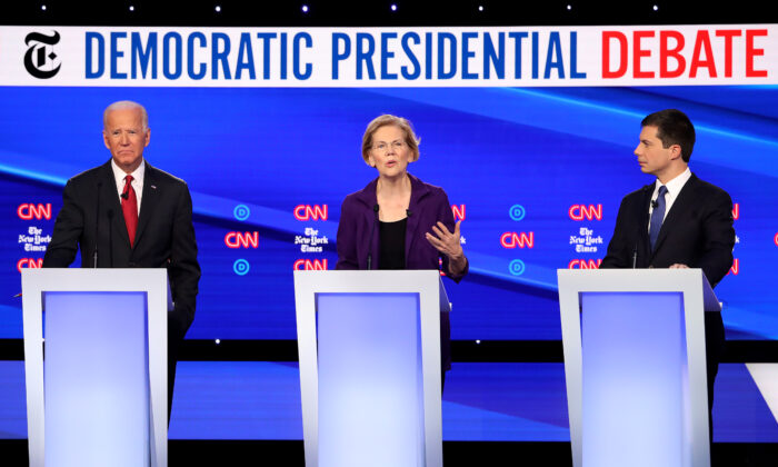 Sen. Elizabeth Warren (D-MA) (C) speaks as former Vice President Joe Biden and South Bend, Indiana, Mayor Pete Buttigieg look on during the Democratic Presidential Debate at Otterbein University in Westerville, Ohio, on Oct. 15, 2019.  Win McNamee/Getty Images