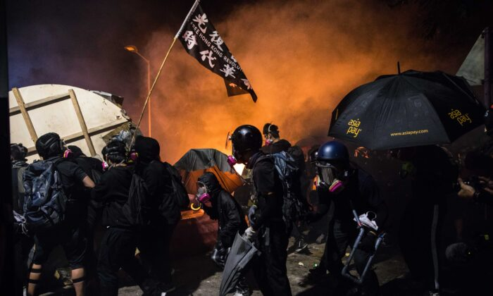 Protesters gather during clashes with police at the Chinese University of Hong Kong (CUHK), in Hong Kong on Nov. 12, 2019. (Dale De La Rey/AFP via Getty Images)
