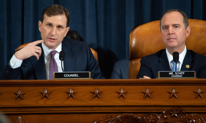 Democratic Counsel Daniel Goldman questions top U.S. diplomat in Ukraine William B. Taylor Jr. as Chairman Adam Schiff (D-CA) listens during the first public hearings held by the House Permanent Select Committee on Intelligence as part of the impeachment inquiry into U.S. President Donald Trump on Capitol Hill in Washington on Nov. 13, 2019. (Saul Loeb - Pool/Getty Images)