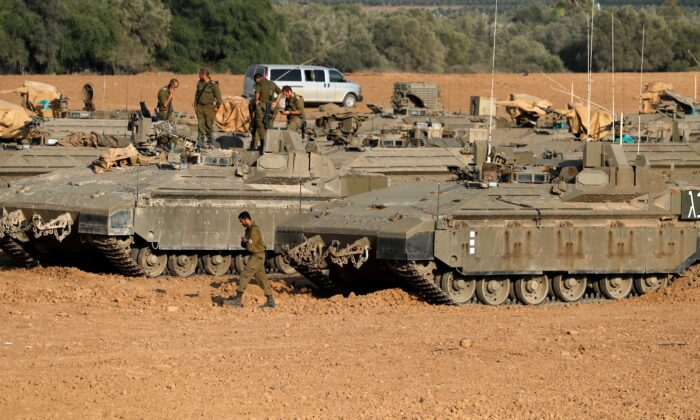 Israeli armoured vehicles are stationed at about 10kms from the southern Israeli city of Sderot, near the border with the Gaza Strip on Nov. 14, 2019. (Photo by Ahmad Gharabli/AFP via Getty Images)
