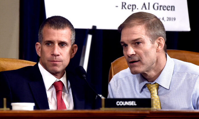 Rep. Jim Jordan (R-Ohio), right, and minority counsel Steve Castor confer during the first public impeachment hearing on Nov. 13, 2019. (Olivier Douliery/AFP via Getty Images)