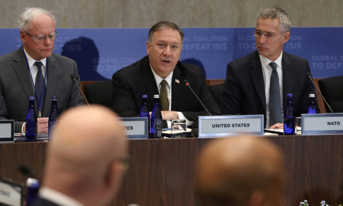 Secretary of State Mike Pompeo (C) speaks during a meeting of the Global Coalition to Defeat ISIS, at the State Department in Washington on Nov. 14, 2019. (Mark Wilson/Getty Images)