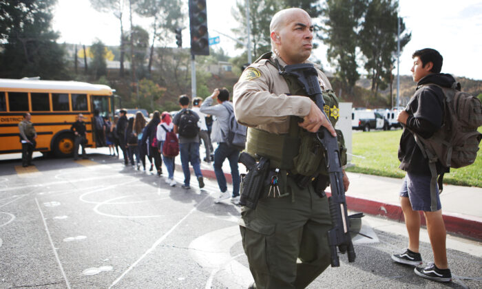 Students are evacuated from Saugus High School onto a school bus after a shooting at the school left two students dead and four wounded in Santa Clarita, Calif., on Nov. 14, 2019. (Mario Tama/Getty Images)