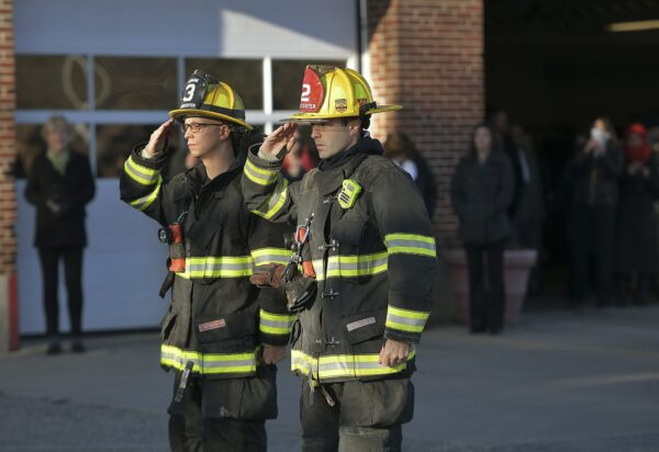 Two Firefighters salute