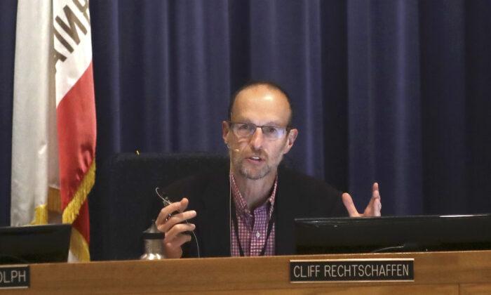California Public Utilities Commissioner Cliff Rechtschaffen speaks at a CPUC meeting in San Francisco, on Nov. 13, 2019. (AP Photo/Jeff Chiu)