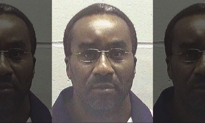 This undated file photo made available by the Georgia Department of Corrections, shows inmate Ray Jefferson Cromartie in custody. He was convicted of malice murder and sentenced to death for April 1994's slaying of Richard Slysz at a Thomasville, Ga., convenience store. (Georgia Department of Corrections via AP, File)