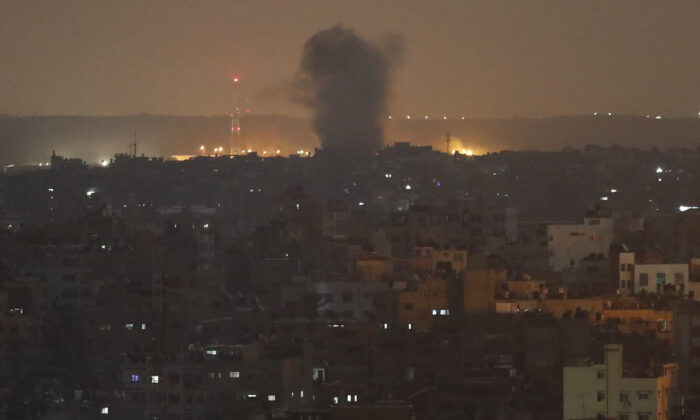 An explosion caused by Israeli airstrikes is seen in Gaza City, early Nov. 14, 2019. (AP Photo/Adel Hana)
