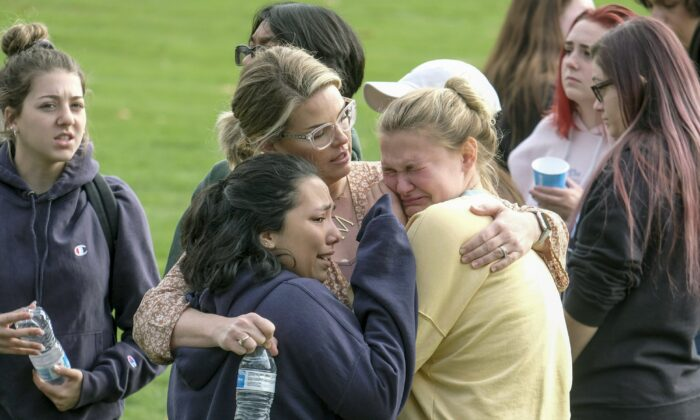 Students are comforted as they wait to be reunited with their parents following a shooting at Saugus High School that injured several people, in Santa Clarita, Calif., Nov. 14, 2019. (Ringo H.W. Chiu/AP Photo)
