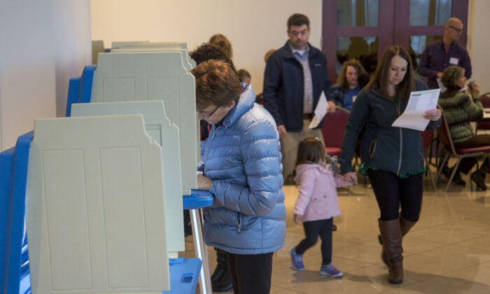 Voters go to the polls to cast their midterm ballots at the Annunciation Greek Orthodox Church Cultural Center on Nov. 6, 2018 in Wauwatosa, Wis. (Darren Hauck/Getty Images)