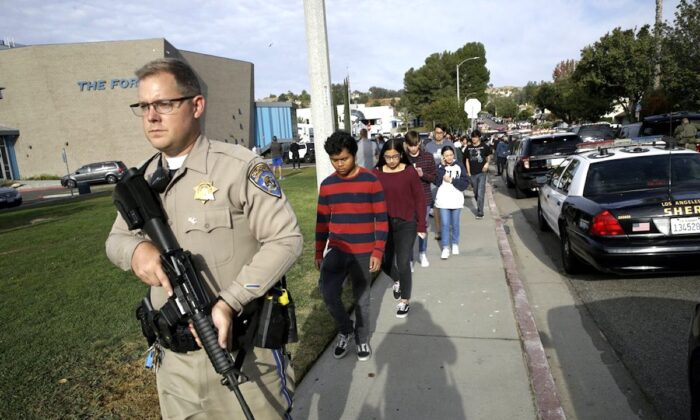 Students are escorted out of Saugus High School after reports of a shooting in Santa Clarita, Calif., on Nov. 14, 2019. (Marcio Jose Sanchez/AP Photo)