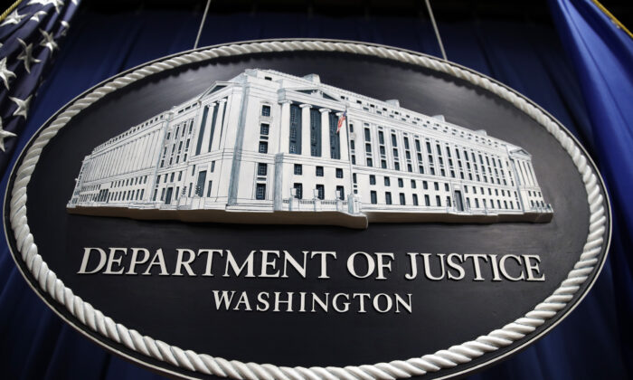 A sign for the Department of Justice hangs in the press briefing room at the Justice Department in Washington on April 18, 2019. (Patrick Semansky/AP Photo)