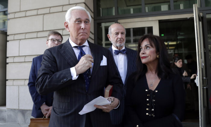 Roger Stone, left, with his wife Nydia Stone, leaves federal court in Washington on Nov. 15, 2019. (AP Photo/Julio Cortez)