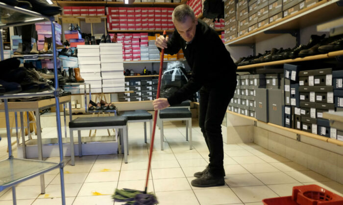 A man cleaning in a file photo. (Manuel Silvestri/Reuters)
