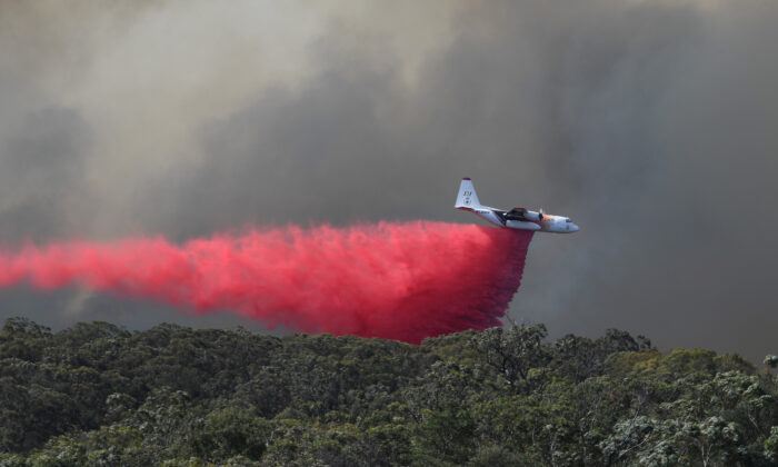 An air tanker drops fire retardant on the Gospers Mountain fire near Colo Heights, northwest of Sydney, Australia, on Nov. 15, 2019. (AAP Image/Dean Lewins/via Reuters)