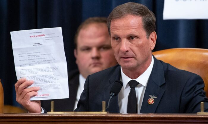 U.S. Rep. Chris Stewart (R-Utah) holds up a copy of the transcript of a phone call between U.S. President Donald Trump and Ukrainian President Volodymyr Zelensky. (Photo by Saul Loeb - Pool/Getty Images)