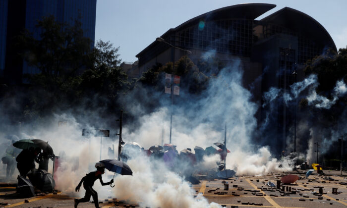Protesters clash with police outside Hong Kong Polytechnic University (PolyU) in Hong Kong, on Nov. 17, 2019. (Thomas Peter/Reuters)
