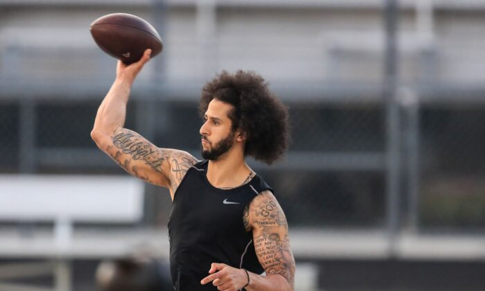 Colin Kaepernick makes a pass during a private NFL workout held at Charles R. Drew high school in Riverdale, Georgia on Nov. 16, 2019. Due to disagreements between Kaepernick and the NFL the location of the workout was abruptly changed. (Carmen Mandato/Getty Images)