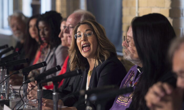 "Naomi Klein, author of ""This Changes Everything: Capitalism vs. the Climate,"" joins other activists, actors, and musicians in launching the Leap Manifesto, outlining a climate and economic vision for Canada, during a press conference in Toronto on Sept. 15, 2015. (THE CANADIAN PRESS/Darren Calabrese)"