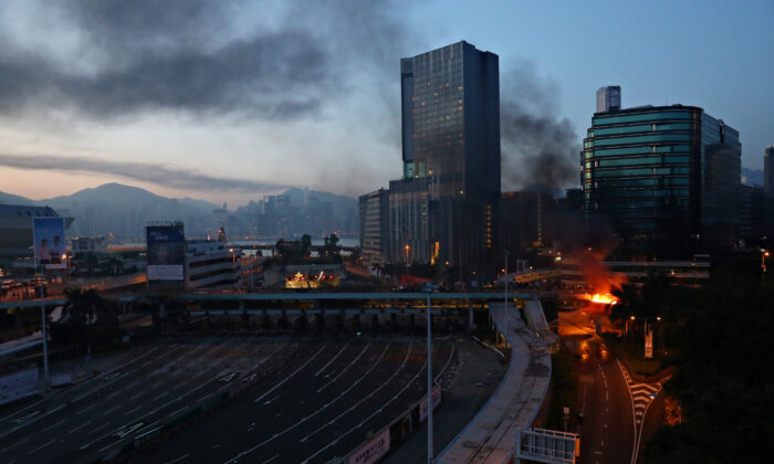A fire is seen at the Hong Kong Polytechnic University (PolyU) in Hong Kong, on the early morning of November 18, 2019. (REUTERS/Athit Perawongmetha)