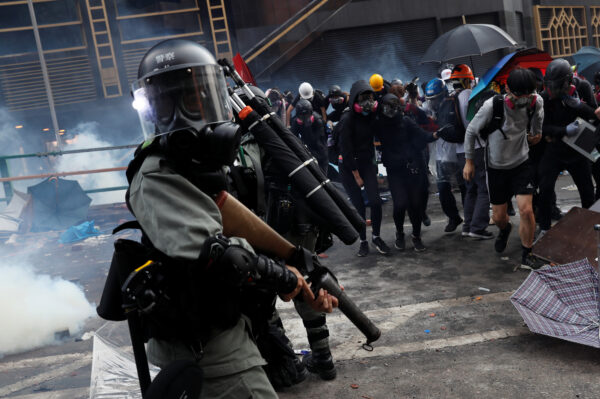 Protesters attempt to escape from tear gas