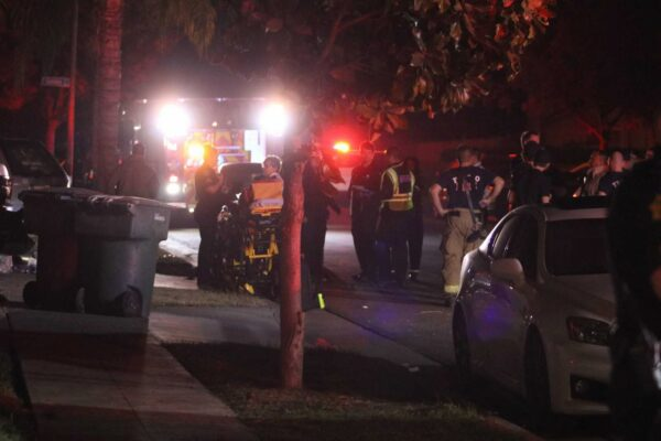 Police and emergency personnel work at the scene of a shooting