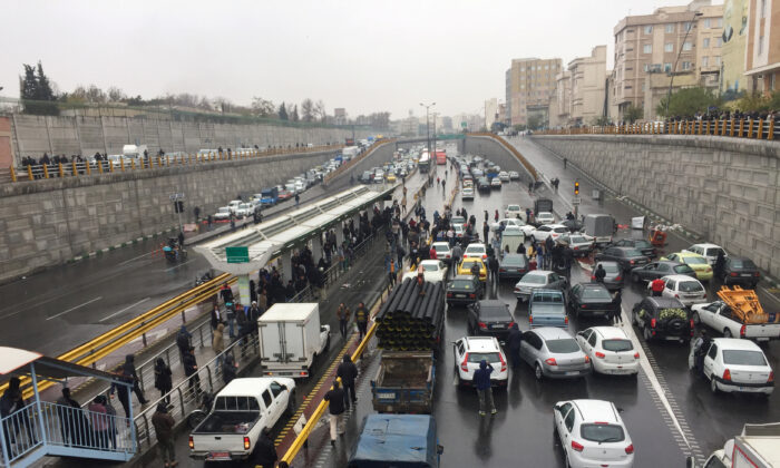 People stop their cars on a highway to protest against increased gas price in Tehran, Iran, on Nov. 16, 2019. (Nazanin Tabatabaee/West Asia News Agency via REUTERS)