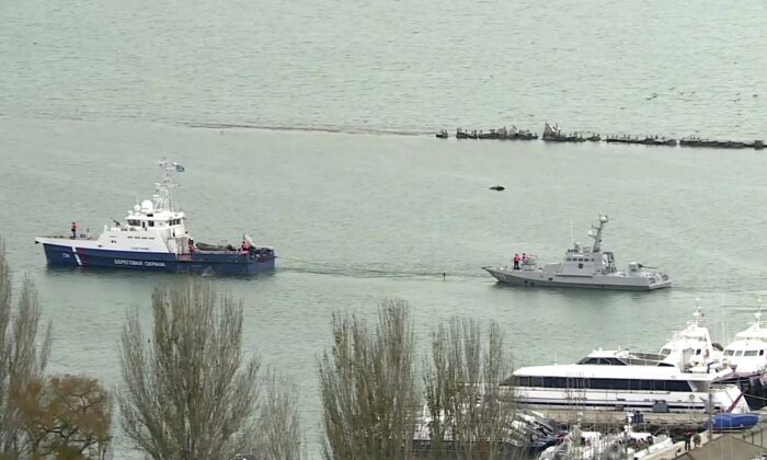This video grab provided by the Krym 24 tv station via AP Television shows a seized Ukrainian ship, right, being towed by a Russian coast guard boat out of the port in Kerch, Crimea on Nov. 17, 2019. (Krym 24 tv station via AP Television)