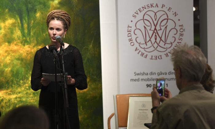 """Swedish Culture and Democracy Minister Amanda Lind presents the Swedish PEN's Tucholsky Prize given to Chinese-Swedish book publisher Gui Minhai in Stockholm, Sweden on Nov. 15, 2019.  China on Friday threatened """"counter-measures"""" against Sweden if the culture minister awards a Swedish PEN rights prize as planned to detained Chinese-Swedish book publisher Gui Minhai. (Fredrik Sandberg/TT News Agency/AFP via Getty Images)"""