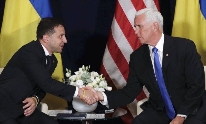 Vice President Mike Pence shakes hands with Ukrainian President Volodymyr Zelensky at a meeting in Warsaw, Poland, on Sept. 1, 2019. (AP)