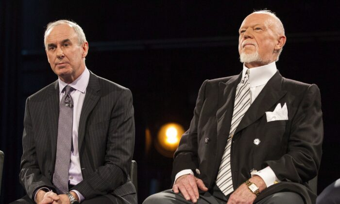 "Ron MacLean (L) sits beside Don Cherry as Rogers TV unveils their team for the station's NHL coverage in Toronto on March 10, 2014. MacLean addressed Don Cherry's dismissal during the first intermission of Saturday's ""Hockey Night in Canada"" broadcast. (The Canadian Press/Chris Young)"