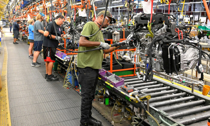 U.S. Manufacturing: Engines are assembled as they make their way through the assembly line at the General Motors (GM) manufacturing plant in Spring Hill, Tennessee, on Aug. 22, 2019. (Reuters/Harrison McClary/File Photo)